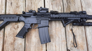 Shooting a Full Auto SBR, while shouldering. The Panther Arms DPMS  SBR.